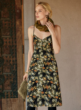 Set against a black ground, hand-painted cherry blossoms adorn our seductive A-line slip dress in gold, cream, persimmon and olive. Skimming the body in fluid viscose, it has a double v-neck, adjustable spaghetti straps, contoured seams and pockets.