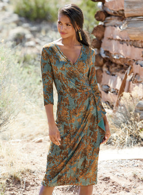 A portrait of autumn, this alluring faux wrap dress is patterned with gold and amber leaves adrift on a robin's egg blue sky. Sewn of fluid viscose (95%) and elastane (5%) jersey, it's strategically gathered and pleated for a fabulous fit, with crossover v-neck, ¾-sleeves and slimming shirring at the side panel.