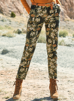 The chic, cropped stretch twill trousers are patterned in cherry blossoms of alabaster, gold and persimmon on black. Eased fit; straight legs, front trouser pockets; back welt pockets. In cotton (97%) and spandex (3%).