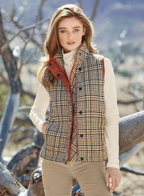 The quilted vest is a handsome piece to layer over a sweater or under a coat when the temperature plummets. Patterned in a classic plaid of burnt orange, cream, olive and deep navy. Expertly tailored with a high stand collar, hidden zipper-and-snap placket, contrast binding and pockets; lined. Polyester (76%) and cotton (24%).