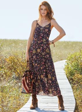 Auf unserem fließenden Kleid heben sich persische Blumenranken vom schwarzen Grund ab. Aus Viskosecrèpe; V-Ausschnitt vorn und hinten; verstellbare Spaghettiträger; Taschen.