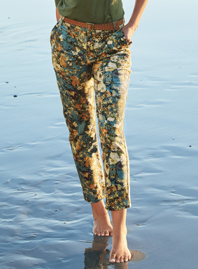 The chic, cropped stretch twill trousers showcase an Asian floral.  Eased fit; straight legs; front trouser pockets; back welt pockets. Cotton (97%) and spandex (3%).