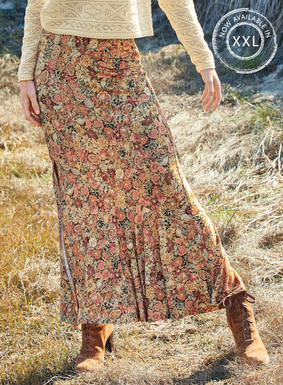 Nach einer antiken Gobelinstickerei: Den Jersey-Maxirock zieren Blüten in frühlingshaften Pastelltönen. Aus 95 % Viskose und 5 % Elasthan genäht, mit asymmetrischem Volantsaum und leicht versetztem Schlitz vorn.