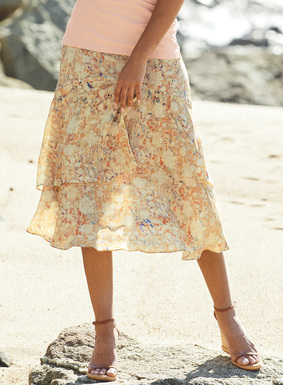 Landscaped in painterly, flowering vines, the romantic skirt is constructed in two floaty tiers of viscose that cascade gracefully to the hem.