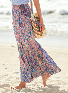 Impressionistic stippling dapples the maxi-skirt in a palette of soft sunrise hues. The graceful wrap silhouette in stretchy, woven viscose (94%) and elastane (6%) has a long side tie and curved seaming, flaring at the knee to a flounced hem.