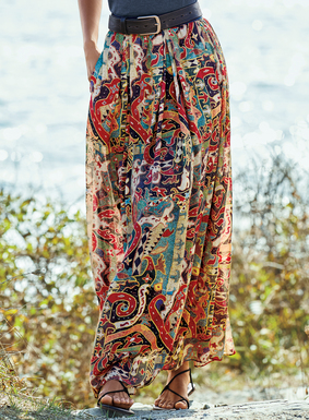 Abstract motifs from an Indonesian tile pattern our flowy maxi-skirt in hues of red, melon, dusty blue, cream and midnight. Sewn of drapy rayon (68%) and modal (32%), it's styled with an exposed wide elastic waistband and pockets; lined.