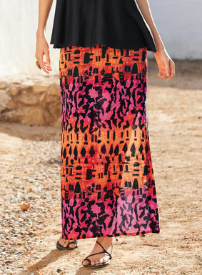 Moroccan rug motifs are reimagined on a shifting ground of orange coral, hot pink and fuchsia ground. Our eye- catching maxi-skirt is sewn of stretchy, woven viscose (94%) and elastane (6%), with a side zip and deep side slits.