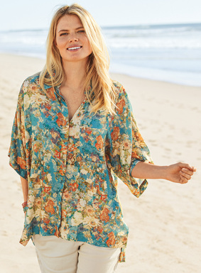 The casually relaxed camp shirt is printed in antique florals on a sky blue ground. Sewn of flowy viscose. Hidden placket; chest pocket; side slits; steps longer in back.