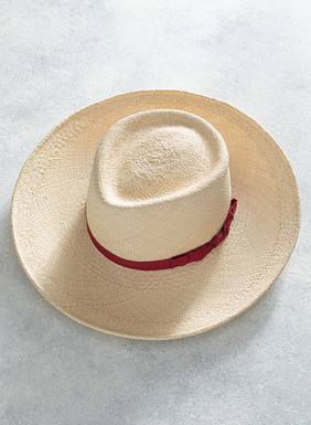 For sun-filled days, the hand-blocked straw Panama hat is trimmed with a madder red grosgrain ribbon.