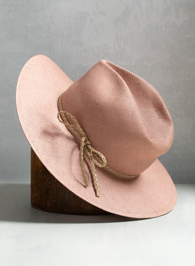 Quite possibly the perfect hat for summer, our Pink Sands Straw Hat. Completely woven by hand, the crushed straw hat blushes in dusty pink, with faux-leather braided band and bow details.