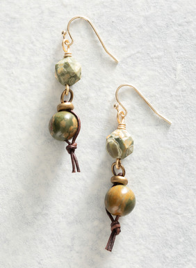 Smooth and rugged rhodolite stones swing from leather cords on the French wire earrings.