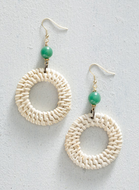 The Raffia Hoop Earrings are topped with green aventurine.