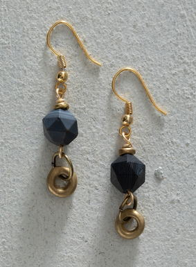 Dangling earrings mix brass rings with facet-cut sardonyx stones. Used as a stone of strength and protection since ancient times, sardonyx is associated with courage, happiness and clear communication. Our earrings also feature gold-plated brass French wires.