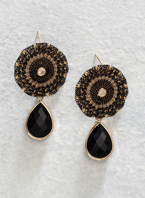 Facet-cut black glass teardrops suspend from the shimmery starburst beaded earrings.