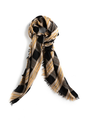 The striking scarf in a gold, beige and black plaid is woven of wool (82%), cotton (14%) and Tencel (4%).