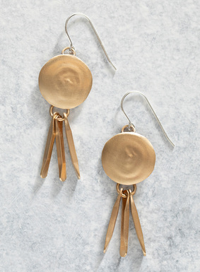 The handcrafted brass disc earrings are fringed with shimmery blades; sterling silver earwires.
