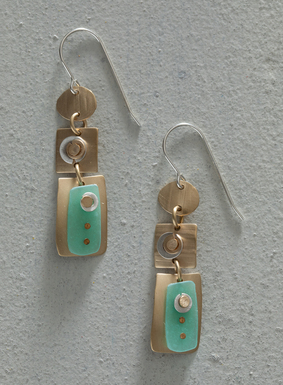 Add a touch of mod metallic to your earring collection. Silver plate discs and seafoam green clay rectangles are riveted onto the artful brass drop earrings.