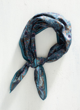 Petite impressionist blooms in deep navy, teal, dusty blue, and brass are framed on an olive ground with a geometric border. Made of cotton, this versatile square bandana can be worn around the neck, tied into hair, wrapped around the wrist, or worn in any other number of ways.