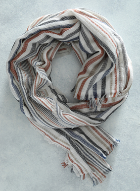 Perfect for early spring temperatures, our beachy striped scarf/shawl is a sunny display of orange, cream, taupe, navy, and slate on textural viscose (55%) and cotton (45%), with an eyelash fringe border.