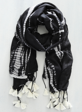 For breezy days, our gauzy tie-dyed scarf in black and white viscose with tassel trim is the perfect accent. Dyed by hand, slight variations in color placement and distribution help to showcase the uniqueness of each handcrafted piece.