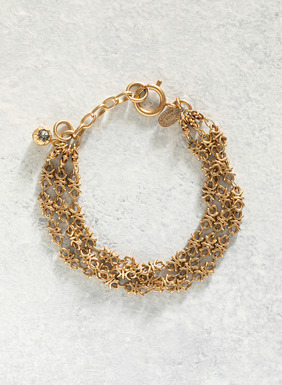 Handmade three strand 14kt gold-plated brass links bracelet with clasp closure and extension chain.