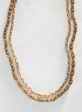 The handcrafted double-strand necklace are dotted with Swarovski® crystals.