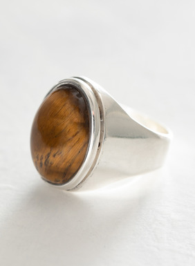 Handcrafted in Peru, this sleek, wear-with-everything sterling silver ring displays a smooth tiger's eye crystal. Roman soldiers are said to have worn tiger's eye when they went into battle because it was believed to bring strength and protection while releasing fear and anxiety. Sales support Peruvian cottage industries working to preserve traditional textile techniques.