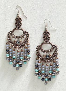 Made in Peru, these gorgeous 3-inch-long statement earrings are made of copper-plated bronze fringed in faceted glass stones of bronze, green, grey, and black. The ear wire is made of silver-plated steel. Sales support Peruvian cottage industries working to preserve traditional textile techniques.
