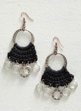 Handmade in Peru, these elegant chandelier earrings feature hammered silver-plated bronze hoops with black hand-crocheted adornments. The ear wire is made of copper-plated steel. Sales support Peruvian cottage industries working to preserve traditional textile techniques.