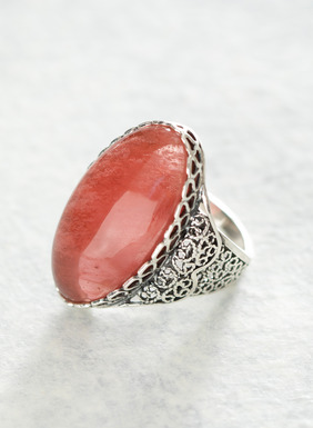 Handcrafted in Peru, this elegant cocktail ring showcases a vibrant pink quartz gemstone in a setting of sterling silver filigree. Sales support Peruvian cottage industries working to preserve traditional textile techniques.