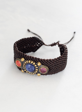 The handwoven bracelet is adorned in stones of sodalite and spondilus set in bronze.