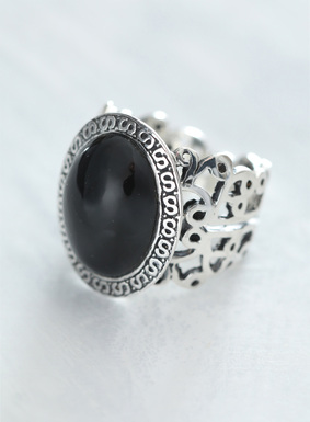 A black obsidian stone is set in sterling silver atop our filigree cocktail ring.  Powerful and believed to protect against negativity, this statement-making stone accent is a must-have for the new season.