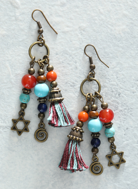 Truly eye-catching, our handcrafted bronze earrings are fringed with semiprecious stones, including reconstituted turquoise and jasper pieces. Bright blue and burgundy cotton yarn tassels dangle alongside brass beads and charms, complete with French wire hooks.