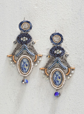 The artisan-made chandelier earrings are a stunning combination of striped and floral fabrics, flanked in faceted blue crystals and glass beads.  A collectible work of art, these earrings require an extensive amount of intricate handwork to create, and are fashioned with silver-plated findings.