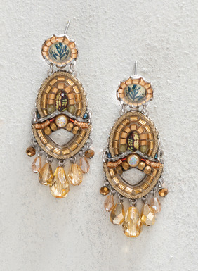 Transform your outfit with these statement earrings, encrusted in amber and champagne glass beadwork with cording and fabric details. Carefully handcrafted and fringed in champagne crystals, these artisan-made earrings are truly a work of art.