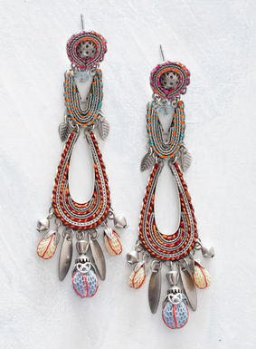 True works of art, these stunning adornments are gallery-worthy. Threaded with colorful yarns in springy pink, orange, blue, and red, the teardrop earrings are fringed with silver-plated flotsam and clear beads wrapped in netting.