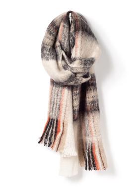 Der kuschelige karierte Schal ist aus einem Bouclégarn aus 55 % Acryl, 25 % Wolle und 20 % Nylon.