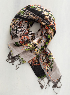 Colorful embroidered florals are resplendent on the fringed viscose (48%), cotton (33%) and wool (19%) scarf; reverses from black to cream. A wonderful gift for all ages.