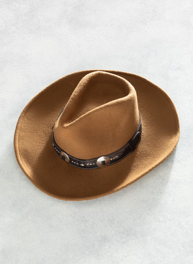 This honey-colored wool felt hat is given a western flare with a dark brown leather band adorned with silver-plated studs and buckles.