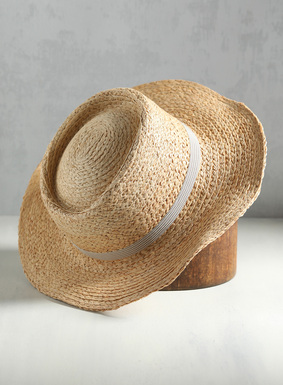 Bring on the sunshine. Our wide-brimmed straw hat is trimmed with a striped grosgrain ribbon of stone and cream, and looks fabulous with dresses and jeans alike.