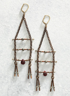 Handcrafted in the USA, these antiqued brass ladder earrings feature facet-cut garnet, pyrite, and glass with a leverback closure.