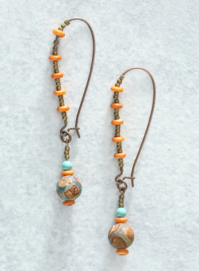 Anchored by a tear drop French wire hook with brass and coral bone beading, our earrings feature semiprecious turquoise stones and a large Tibetan agate.  Regarded as a talisman, the agate bead is believed to bring good fortune, health, and long life.