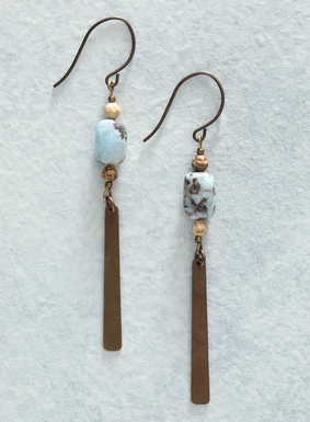 Our Tidal River Earrings make for an earthy, modern, and oh-so-chic addition to any look. Brass blade pendants swing from the delicate agate and teal larimar stone earrings, with French wire hooks.