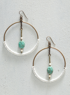 Evoking an intriguing mobile, smooth agate, opal, and brass stones suspend from the linen-wrapped, brass hoop earrings. A touch of crochet detailing and French wire hooks complete these bohemian baubles.