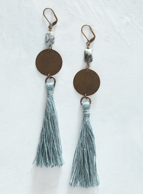 "Indigo-dyed linen tassels dangle from a brass disk and larimar stone in these dramatic earrings.  At 5 1/2"" in length, the shoulder-dusting earrings are sure to make a statement this season."