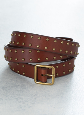 Our wear-with-everything leather belt is bordered in brass studs, for an updated yet classic style.  Pair it with your favorite pants, or layer it over dresses and skirts for an added textural element.