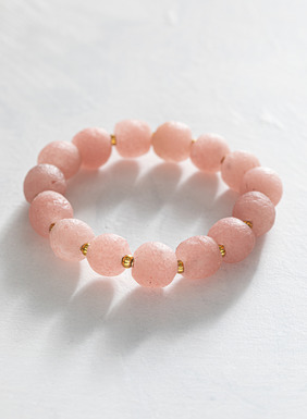Handmade frosted rose hued glass stretch bracelet with petite brass spacers.