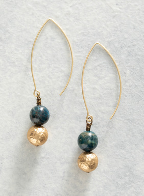 Hammered brass and blue apatite beads swing from the brass wire earrings.