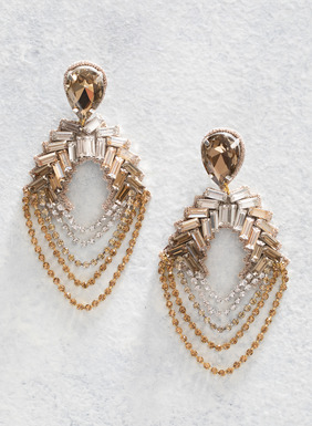 The earrings add sparkle, in a treasure trove of faceted glass teardrops, crystal baguettes and rhinestone swags; sterling silver posts.