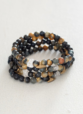 Handcrafted set of 4 stretch bracelets made with tiger eye and brass findings.
